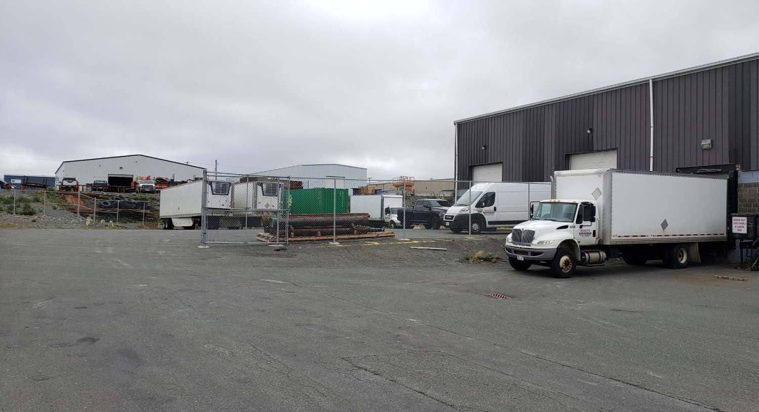 fleet of trucks parked outside the facility